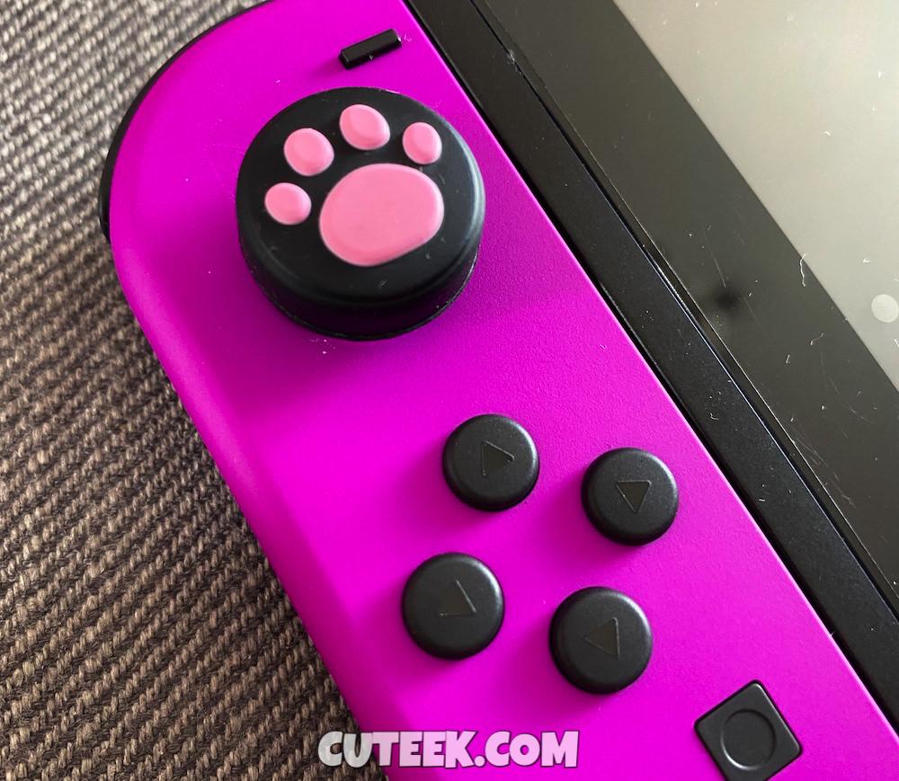 Purple Nintendo Switch Joycon with pink paw thumbgrips