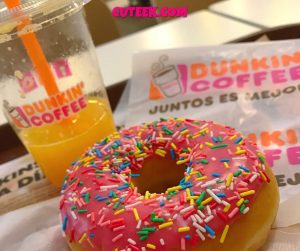 Happy National Donut Day | Pink Dunkin donut with sprinkles and orange juice