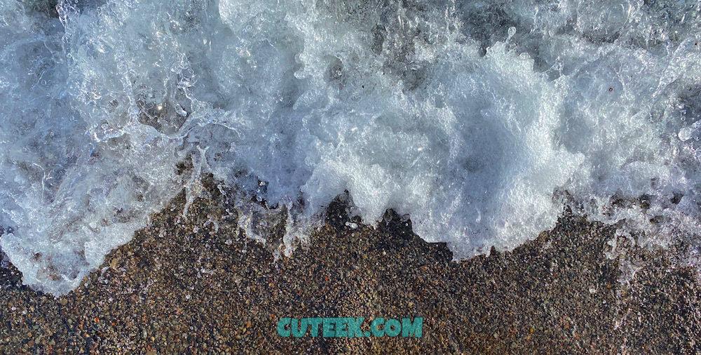 waves crashing on pebble beach